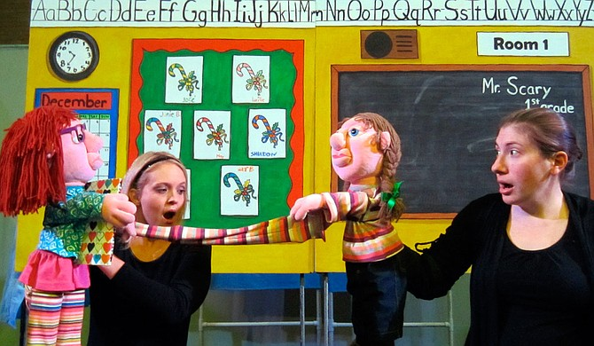 "In Mississippi Puppetry Guild's production of ""Jingle Bells, Batman Smells,"" Keni Bounds (left) plays the puppet version of Junie B. Jones, and Lesley Raybon (right) plays the puppet version of May. Photo courtesy Mississippi Puppetry Guild"
