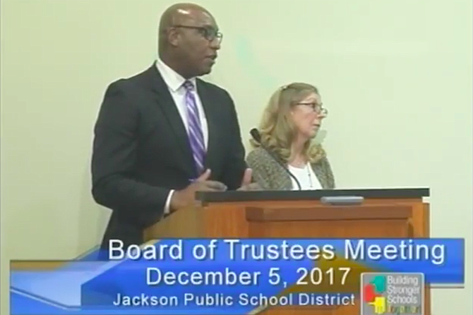 William Merritt (left) and Ann Moore (right) explain the contracts with the Bailey Group to the JPS Board of Trustees at its Dec. 5 meeting. Photo courtesy JPS TV
