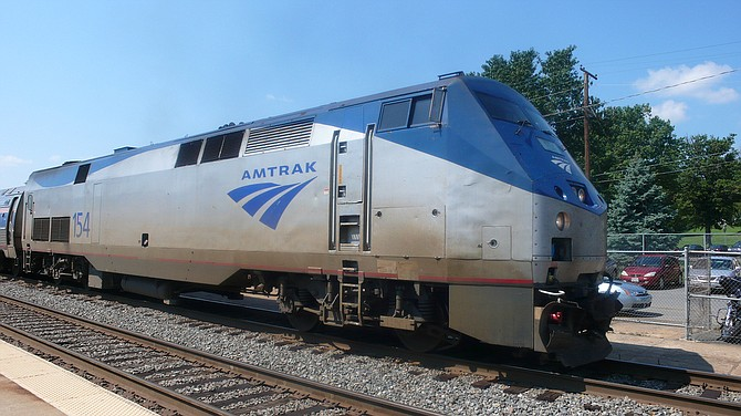 An Amtrak train making the first-ever run along a faster new route hurtled off an overpass Monday near Tacoma and spilled some of its cars onto the highway below, killing at least six people, authorities said. The death toll was expected to rise. Photo courtesy Flickr/Oliver