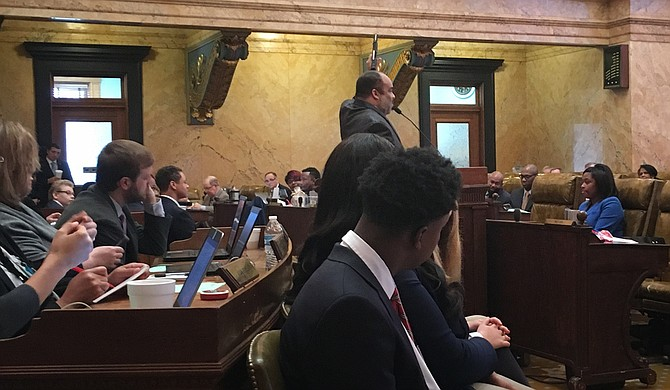 Rep. Charles Young, D-Meridian, brandished his unloaded gun on the House floor on Feb. 8, as he spoke on House Bill 1083, which would allow Mississippians with enhanced carry licenses to bring claims against public entities, including universities, with policies that prohibit them from carrying weapons on public property.