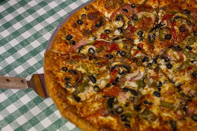 Angelo's has dishes such as the Titan pizza with pepperoni, sausage, Canadian bacon, onions, mushrooms, olives and more.