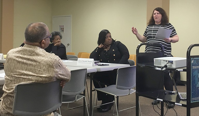 Jennifer Johnson presented polling data from LJR Custom Strategies to the Better Together Commission. It showed that Jackson adults believe teachers are one of the best parts of Jackson Public Schools.