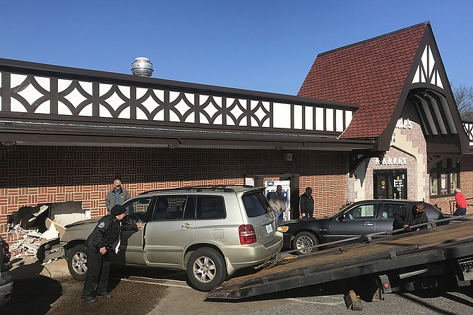 Just after 9 a.m. today, a woman drove her car into the McDade's Market on Fortification Street, hitting a worker inside. Photo by Ko Bragg