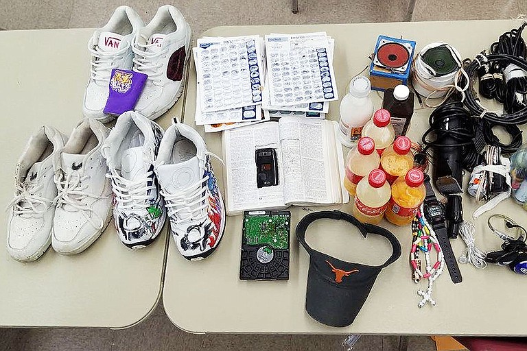 The Mississippi Department of Corrections conducted a second shakedown at South Mississippi Correctional Institution in March, finding tennis shoes, homemade alcohol and one cellphone in what appears to be a book.