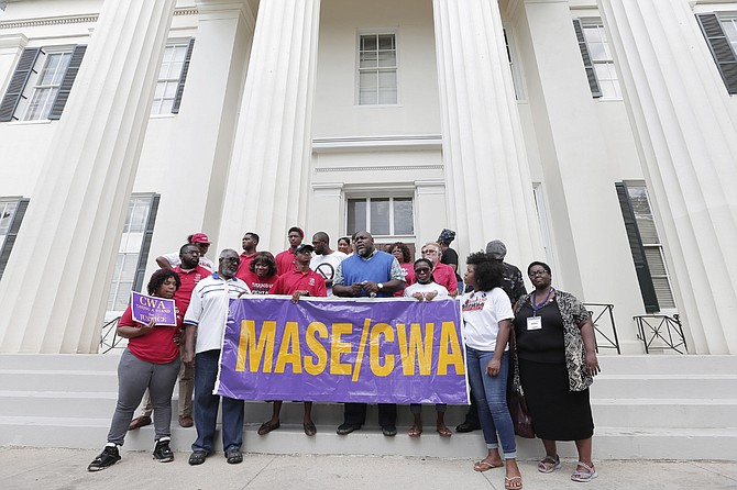 The City of Jackson's employees' union, the Mississippi Alliance of State Employees, Communications Workers of America, will meet Thursday, May 4, to decide next steps to protest the raises given to part-time city council clerks and no other city employees. Union members are pictured at a protest in 2016.