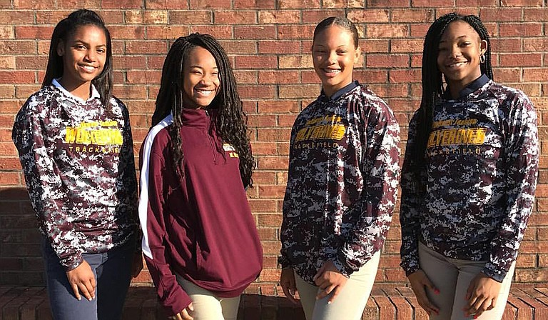 The Wolverines' 4x100 girls relay team, which consists of Mylani Galbreath (right), Jada Cavett (center left), McKinley Washington (center right) and Raylin Dixon (left), won the event in 51.11 seconds.