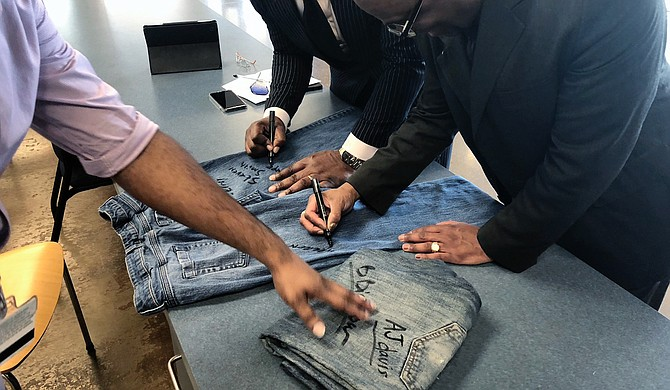 Antonio Horton, a counselor for the Latasha Norman Center and project coordinator for JSU's ONE S.A.F.E. program, encouraged students, faculty and staff to sign pairs of jeans at JSU's Denim Day event to show their support of the campaign.