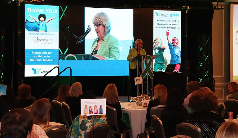 First lady Deborah Bryant spoke out against the stigma of suicide at the children's mental-health summit, noting that her own father committed suicide.
