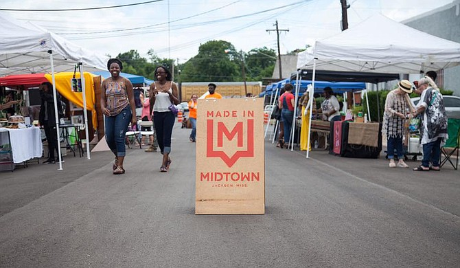 Midfest, an annual street festival and block party, showcases the local businesses and artists in Jackson's midtown arts district.