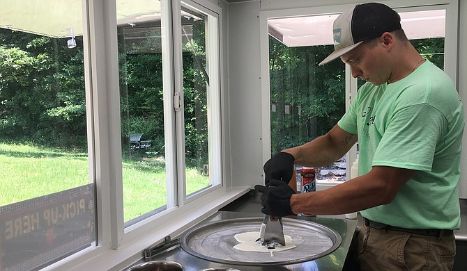 "Ryan Parmentier, co-owner of 30 Below Rolled Ice Cream, chops up Oreos in the ice-cream mix for one of the business' signature dishes, the ""Cookie Jar."""