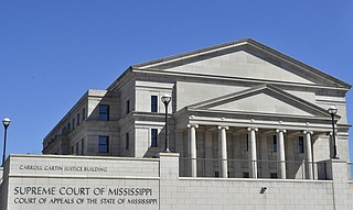 The Mississippi Supreme Court heard arguments Wednesday in a lawsuit that questions the governor's power to make midyear state budget cuts.