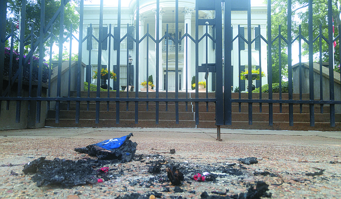 The Mississippi branch of the Poor People's Campaign burned a replica of the Confederate Flag and a Mississippi flag outside the Mississippi Governor's Mansion Monday afternoon.