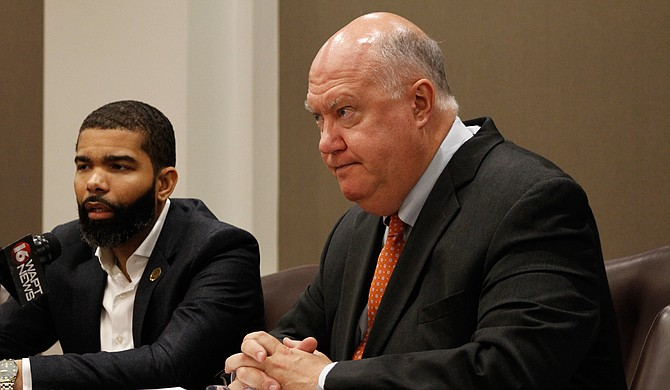Mayor Chokwe A. Lumumba (left) and Public Works Director Bob Miller (right) are advocating for the Jackson City Council to hire three contractors to fill 60 public-works vacancies as sewers collapse across Jackson.