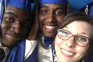 (Left to right) Caleb Kinnard, 19, took a photo with classmate Akeem Knight and teacher Olivia Coté at his Murrah High School graduation only a few weeks before suffering a fatal gunshot wound.