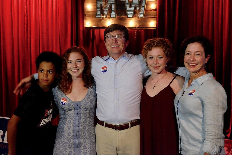 State Representative David Baria poses with his family after winning the Democratic primary runoff race to face Roger Wicker in a run for the U.S. Senate.