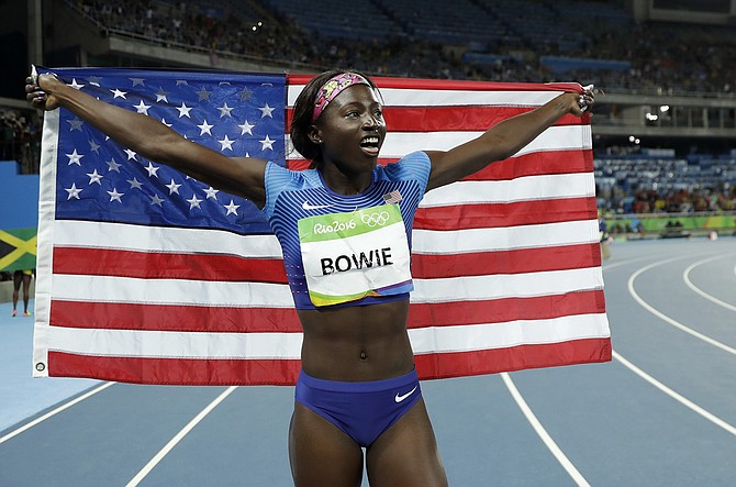 Tori_Bowie_with_flag_courtesy_MS_Sports_Hall_of_Fame_web_t670.jpg?b3f6a5d7692ccc373d56e40cf708e3fa67d9af9d