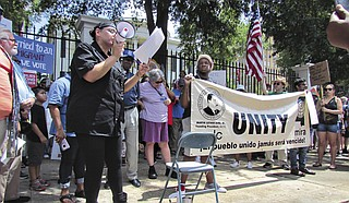 Melinda Medina, a community organizer for the Mississippi Immigrants' Rights Alliance, speaks at a rally to end family separation on June 30.