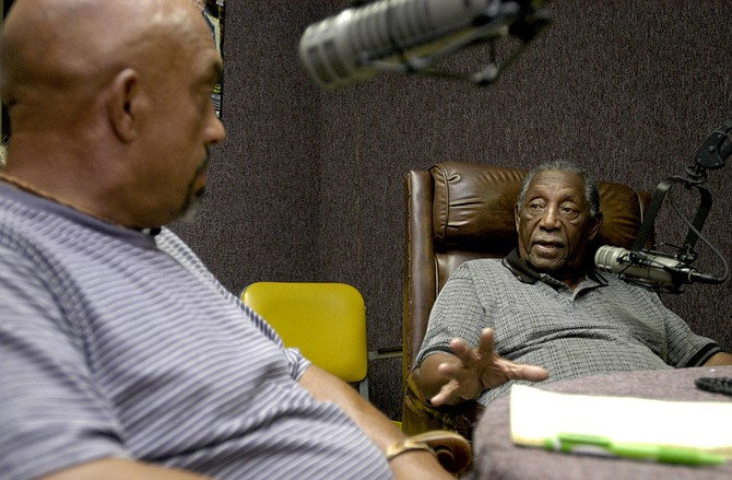Charles Evers, right, interviews Thomas Moore, left, on his radio station in Jackson, Miss., on July 13, 2005, during a journey back to Mississippi to seek justice for the Ku Klux Klan murders in 1964 of his younger brother, Charles Moore, and his friend, Henry Dee.  James Ford Seale died in prison after the journey, accompanied by the Jackson Free Press, inspired a federal trial. Evers is the brother of slain civil-rights leader Medgar Evers. Photo by Kate Medley