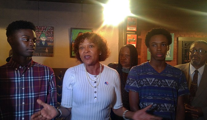 Jackson Public Schools Board President Jeanne Middleton Hairston addressed the media following the passage of the bond referendum on Aug. 7. On her left is Murrah High School sophomore Khai Thompson, and Lanier High School senior Joseph Jiles is on her right.
