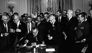 President Lyndon B. Johnson signed the Civil Rights Act of 1964, which included Title IV provisions to de-segregate public schools that the U.S. Supreme Court had ordered in 1954. However, it would take another high court decision in 1969 to force desegregation of all Mississippi schools.