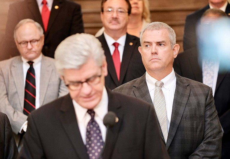 Mississippi House Speaker Philip Gunn, R-Clinton, right, attends a press conference in Jackson on Aug. 23, 2018, as Gov. Phil Bryant speaks in support of a bill to create a state lottery. Gunn chose not to block a vote on the lottery, despite personal opposition to the creation of one. Photo by Ashton Pittman