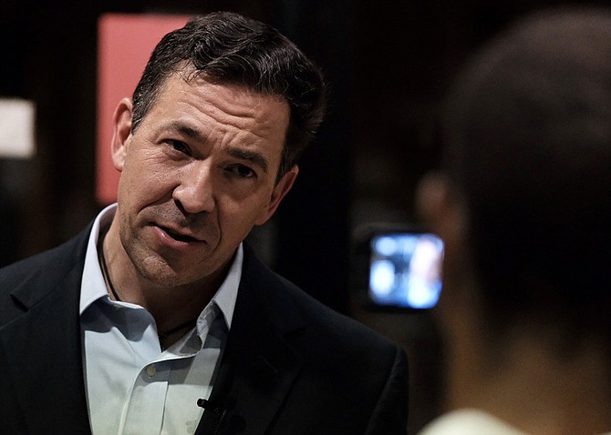Mississippi U.S. Sen. candidate Chris McDaniel embraced President Trump's trade agenda and accused his opponent, incumbent Republican U.S. Sen. Cindy Hyde-Smith, of being weak on trade. Seen here on Aug. 30, McDaniel talks to a reporter at a town-hall campaign stop in Petal, Miss.