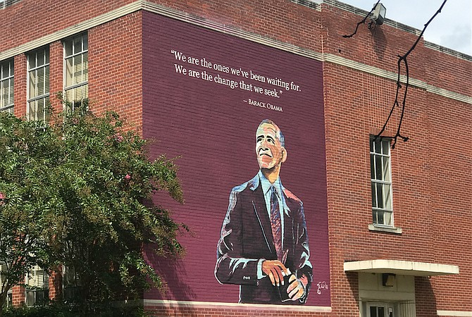 Jackson State University alumni Charles and Talamieka Brice unveiled a mural depicting former President Barack Obama, which the husband-and-wife design team painted along the south wall of Barack Obama Magnet IB Elementary School in Jackson, on Friday, Aug. 17.