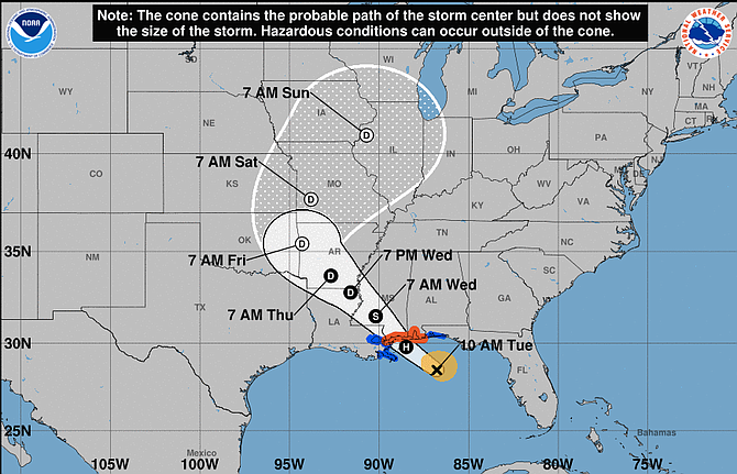 """A hurricane warning is in effect for the entire Mississippi and Alabama coasts. The National Hurricane Center predicted a """"life-threatening"""" storm surge of 3 to 5 feet (0.9 to 1.5 meters) along parts of the central Gulf Coast."""