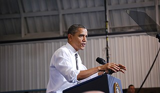 Former President Barack Obama issued a scorching critique of his successor Friday, blasting President Donald Trump's pattern of pressuring the Justice Department, his policies and reminding voters that the economic recovery—one of Trump's favorite talking points—began on his watch.