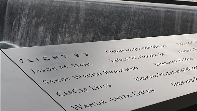 Thousands of 9/11 victims' relatives, survivors, rescuers and others who gathered on a misty Tuesday morning at the memorial plaza where the World Trade Center's twin towers once stood.