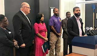 Mayor Chokwe Antar Lumumba (right) signed an executive order Monday, Sept. 24, officiating a Bill of Rights for those who pay for water and sewer in Jackson before the City begins shutting off water to nonpaying customers. Photo by Ko Bragg