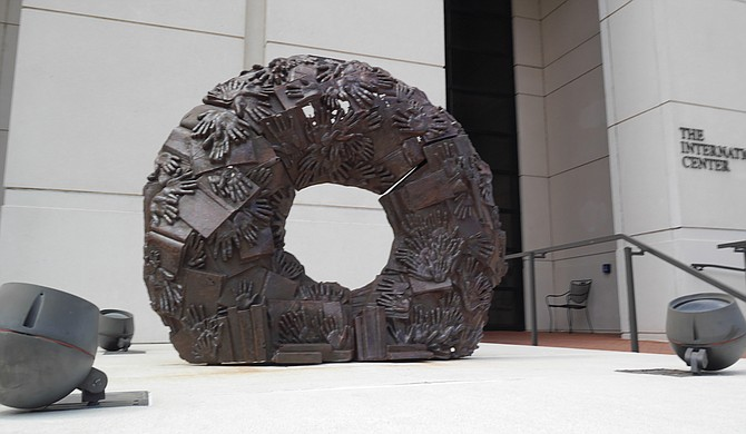 """Eudora Welty Wreath,"" the iron sculpture that Tordella-Williams created for the exhibition, features castings of handprints from patrons of the Eudora Welty Library in Jackson, as well as cast-off books from a book sale at the library. Photo courtesy Millsaps College"