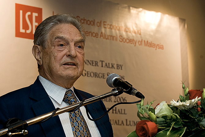 George Soros, who made his fortune in hedge funds, frequently donates to liberal causes. Recently, conservative critics have accused him without evidence of secretly financing the caravan of Central American migrants making their way toward the U.S. Photo courtesy Wikimedia Commons/Jeff Ooi