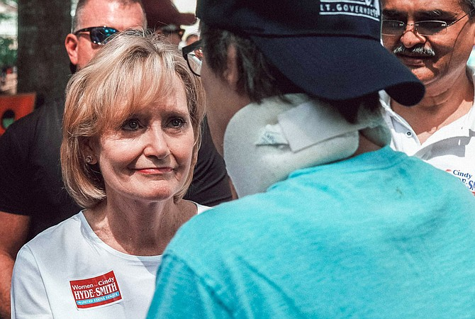 U.S. Sen. Cindy Hyde-Smith, R-Miss., listens to a constituent's health-care concerns at the Neshoba County Fair on Aug. 2, 2018. On Oct. 10, she voted to allow the expansion of plans that can deny pre-existing conditions coverage.