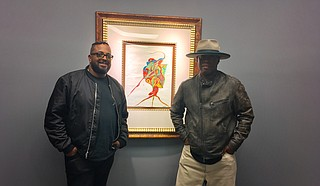 "(Left to right) Erin Davis and Vince Wilburn Jr., the youngest son and nephew of iconic trumpet-player Miles Davis, attended the opening reception for ""We're Miles Ahead: The Miles Davis Exhibition,"" which is on display at Jackson State University's downtown campus through Nov. 30."