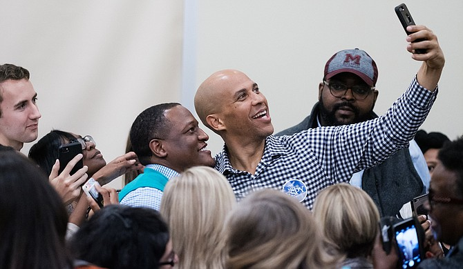 U.S. Sen. Cory Booker takes selfies with college students at the University of Southern Mississippi, where he campaigned for Democratic U.S. Senate candidate Mike Espy on Nov. 19. Photo by William Pittman