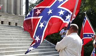 A federal appeals court is not reviving a lawsuit that tried to block a Mississippi city from flying the state flag that includes the Confederate battle emblem.