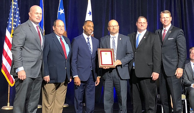 Acting U.S. Attorney General Matthew Whitaker honored Mississippi's Project EJECT at the Project Safe Neighborhoods Conference in Kansas City, Mo., on Dec. 6, 2018. Left to right are: Whitaker, Hinds County Assistant District Attorney Pat McNamara, Jackson Police Department Assistant Chief Ricky Robinson, First Assistant U.S. Attorney Darren LaMarca, U.S. Attorney's Office Criminal Chief Courtney Coker and U.S. Attorney Mike Hurst. Photo courtesy U.S. Attorney Mike Hurst's Office
