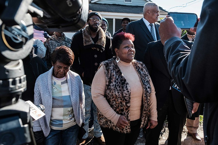 "Bettersten Wade, the sister of George Robinson, demands ""justice"" at a press conference at the site where her brother's encounter with police began. Next to her is his mother, Vernice Robinson."