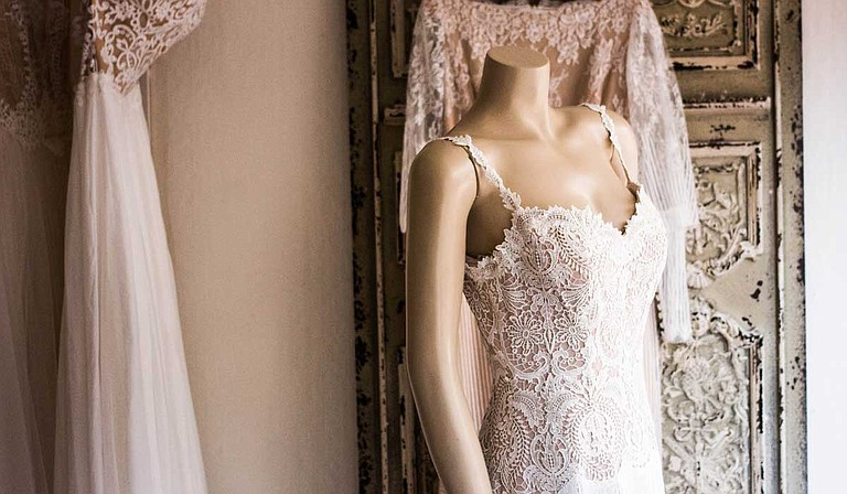 While some wedding traditions will remain, new ones have popped up, including dresses with statement backs, nontraditional venues and mix-and-match bridesmaid dresses. Photo courtesy Charisse Kenion/Unsplash