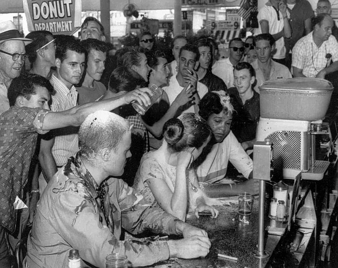 In 1963, Anne Moody participated in the famous sit-in at Woolworth lunch counter in Jackson, together with fellow Tougaloo student Joan Trumpauer and Tougaloo professor John Salter Jr. A white mob attacked Moody and her companions and poured flour, sugar, ketchup and mustard on them. Photo courtesy AP/Fred Blackwell/Jackson Daily News