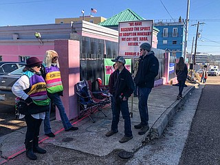 Clinic escorts, who help patients at the Jackson Women's Health Organization avoid anti-abortion protesters, engage with child protesters on the sidewalk in Fondren on Jan. 24, 2019.