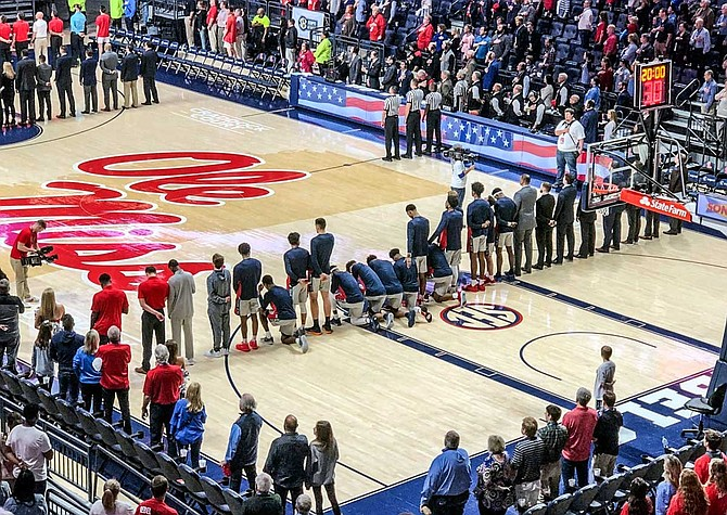 Eight Mississippi players kneeled during the national anthem in response to a Confederacy rally near the arena before the Rebels' 72-71 victory over Georgia on Saturday. Photo courtesy Nathanael Gabler/The Oxford Eagle via AP