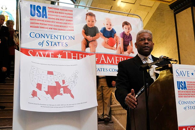 Retired U.S. Army Lt. Col. Allen West speaks in the Mississippi Capitol rotunda to support a resolution for a new constitutional convention. A map behind him shows the state legislatures that have already passed resolutions.