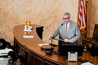 Mississippi House Speaker Philip Gunn whipped up enough votes to move a funding bill forward to the governor's desk after Republicans slipped $2 million for private school vouchers in at the last minute.