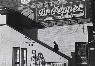 """An African American man enters the """"colored"""" entrance of a segregated movie theater in Belzoni in Humphreys County, Miss., in 1939. Photo by Marion Post Wolcott"""