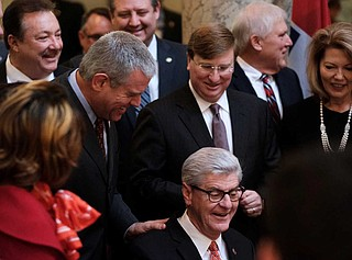 Mississippi House Speaker Philip Gunn put his hand on Gov. Phil Bryant's shoulder as the state's top Republican signed the Mississippi Broadband Enabling Act into law in January.