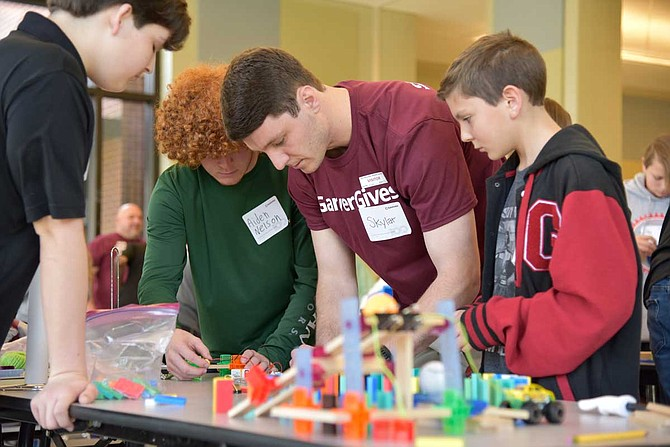 Garver sent a group of engineers to Germantown Middle School to observe the students' devices for the Garver Chain Reaction Challenge and teach them about STEM subjects, or science, technology, engineering and math. Photo courtesy Garver