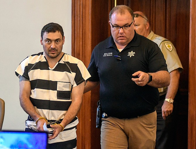 Lafayette County Sheriff Dept. Maj. Alan Wilburn (right) escorts Oxford Police Officer Matthew Kinne (left) into a hearing at the Lafayette County Courthouse, Wednesday, May 22, 2019, in Oxford, Miss. Kinne is charged in the death of 32-year-old Dominique Clayton, who was found dead Sunday. Photo by Bruce Newman/The Oxford Eagle via AP
