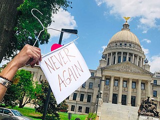 Yazoo City resident Mindy Brown protested for abortion rights outside the Mississippi Capitol on May 21 with this prop—an allusion to a pre-Roe era when women used hangers to self-induce abortions, often with deadly results.